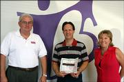 Hank Booth, left, and Becky Price, right, present Craig Miller with a Platinum Family Membership to Lawrence Athletic Club on Sept. 7 for being the second-place winner in the Big Brothers Big Sisters of Douglas County's 2005 Bowl For Kids' Sake event. Booth is the 2006 Bowl for Kids' Sake co-chair, and Price is regional executive director of Kansas Big Brothers Big Sisters.
