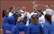 KU softball coach Tracy Bunge talks to the team after the Nebraska Cornhuskers scored five runs in the fifth inning of a spring game.