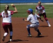 Jackie Vasquez, center, gets caught in a run down during a KU softball game against the Oklahoma Sooners on April 24 in Lawrence. Vasquez says she was wrongfully dismissed from the KU softball team after filing a complaint about the conduct of coach Tracy Bunge after an April 2 loss.