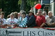 Lawrence High School alumni from the Class of 1965 participate in the LHS homecoming parade Friday.