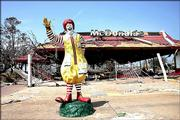Emergency crews signed their names on the still-standing Ronald McDonald statue outside the demolished restaurant on the coast between Biloxi and Gulfport, Miss.