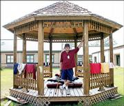 Red Cross volunteer Gary Smith sets up house inside a gazebo outside a Red Cross shelter in Pearl River, La.