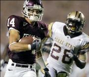 Texas A&M's Chad Schroeder scores on a 44-yard touchdown pass against Texas State. Schroeder has touched the ball five times and has scored five touchdowns this season.