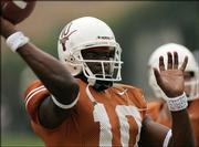 Texas quarterback Vince Young aims for a receiver during the pregame warmup earlier this season. Young, a junior, has led the Longhorns to a 3-0 record and No. 2 national ranking as they head to Columbia, Mo., to take on Missouri today.