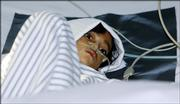 Mutiara Gayatri, 6, who has been infected with bird flu, lies on a bed Friday at a hospital in Jakarta, Indonesia. The World Health Organization revised a prediction from an earlier U.N. estimate of 150 million possible deaths of a flu pandemic to 7.4 million after being deluged with inquiries after releasing the initial estimate.