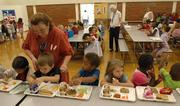 Kindergartners sit down for a school lunch at Kennedy School in this file photo.