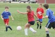 Jenny Freeman, center, works against the Fireballs defense to move the ball downfield for the second Wakarusa goal of the game Saturday at Youth Sports Inc.