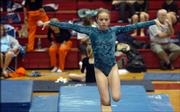 Free State High's Amelia Firns-Hubert steadies herself on the beam. Firns-Hubert placed 10th in the all-around Monday during the Lawrence All-Around Invitational at Lawrence High.