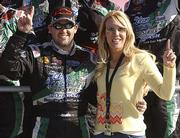 DeLana Harvick, right, celebrates her team's victory in the 2005 Hershey Take 5 300 with driver Tony Stewart.