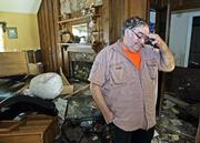 Jerry Golott walks inside his damaged home in Biloxi, Miss. Unable to pay the mortgage on his Biloxi home that is in ruins and unprotected by flood insurance, his travel trailer gone and his wife's job as a harbormaster lost, the 59-year-old retiree is filing for Chapter 7 bankruptcy liquidation.