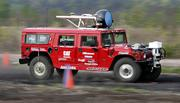 Carnegie Mellon University's  H1ghlander robot runs through a test course in Hazelwood, Pa., in this May 5 file photo. The driverless Hummer snagged the pole position Wednesday in a government-sponsored race across the Mojave Desert.