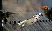 SpaceShipOne, center, the first privately built and piloted vehicle to reach space, is suspended from the ceiling along with other aircraft at the National Air and Space Museum in Washington. SpaceShipOne was donated to the museum Wednesday.