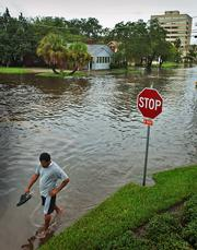 Gregory Aikens wades past a flooded intersection in San Marco, Fla. Heavy rains from Tropical Storm Tammy on Wednesday left several streets impassable in the area. Hurricane experts say that there is still a chance for at least one more powerful storm to hit the U.S. this year. The hurricane season runs through November.