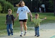 From left, Cooper Hicks, 7, his mother, Lorrie Collins, and her son Brody Hicks, 4, walk to class at Quail Run School. The family was participating in the International Walk to School Day on Wednesday. As the family walked to school for their first time, Collins talked to her sons about safety issues and pointed out crosswalk signs.