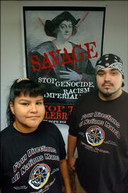 """Lawrence residents, from left, Cricket Gates, and her husband, Anthony Fernandes, are heading to Denver today to participate in a march protesting Columbus Day. Gates said, """"I just feel that people don&squot;t necessarily know the history, and they don&squot;t know exactly what they&squot;re celebrating."""""""