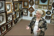 Leila Cohoon, founder of Leila's Hair Museum in Independence, Mo., talks about some of the 300 examples of hairwork that surround her. Wreaths, flowers, hearts, crosses, bald eagles and butterflies - all made from hair - are among the works displayed in shadow boxes at the facility.