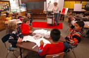 First-graders work on a class lesson at Pinckney School. A poll conducted by the Journal-World and 6News found that two-thirds of Kansans do not see a conflict between belief in God and teaching evolution.