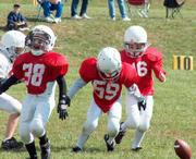 Chops Calton Lovelace, left, Justin Lewis, center, and Hunter Caughbon attempt to recover a fumble Sunday at Youth Sports Inc.