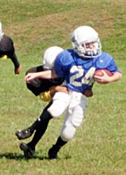 Cougar defenders bring down Hurricane Stan Skwarlo during a kickoff Sunday at Youth Sports Inc.