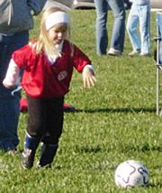 Dragon Hannah Ledbetter concentrates as she prepares to boot the ball Saturday at Youth Sports Inc.