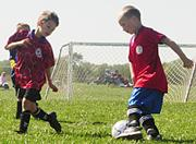 Panthers Cameron Edgecomb, left and Luke Miller look to score against the Tigers on Saturday at Youth Sports Inc. Two late Tiger goals ended the game in a 5-5 tie, which made both teams proud of their play.