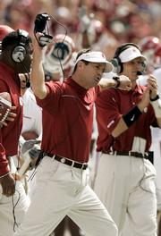 Oklahoma coach Bob Stoops reacts to a play against Texas. Stoops, shown Saturday in Dallas, and the Sooners will play Kansas University on Saturday in Kansas City, Mo.