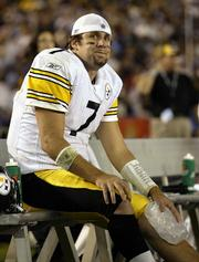 Pittsburgh quarterback Ben Roethlisberger holds an ice pack to his knee after he was injured against San Diego. Roethlisberger's injury wasn't serious, and the QB, shown Monday in San Diego, may play this weekend.