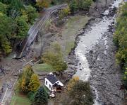 A house is shown Tuesday in Alstead, N.H., where it was deposited after being torn from its foundation and carried downstream by heavy rains this weekend.