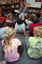 "Quail Run SChool librarian Jane Imber reads to a group of fifth-graders who chose to skip their recess to hear ""Stumptown Kid"" by Carol Gorman, an author who will be visiting the school later this month. Quail Run students received high marks on their reading skills during state tests."
