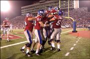 Kansas University's Brian Murphy Jr. is congratulated by his teammates after making a touchdown run late in the fourth quarter of the Jayhawks' 31-14 win over Louisiana Tech on Sept 17.