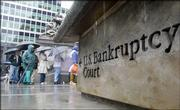 Rain couldn't keep people from filing for bankruptcy protection Friday at U.S. Bankruptcy Court in New York.