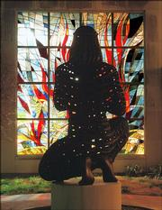 A sculpture of Moses kneeling before a stained-glass burning bush flanks the entrance to Kansas University's Smith Hall, home of the religious studies department. KU is scaling back use of the university seal, which includes a similar image, as part of a marketing campaign.