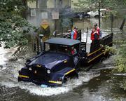 Members of the Wayne Township, N.J., Emergency Management Department drive through flooded streets of the Hoffman Grove neighborhood Saturday in Wayne Township. The neighborhood was flooded by severe rainfall during the past week.