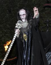 James Keaton performs in his role as Eel Mouth at Universal Orlando's Halloween Horror Nights in Orlando, Fla. The nation's $11 billion amusement industry has appropriated the holiday as its own, helping transform Halloween into a monthlong celebration.