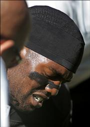 Oakland wide receiver Randy Moss grimaces after injuring his groin during the first quarter against the Chargers. The Raiders fell, 27-14, Sunday in Oakland, Calif.