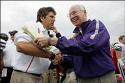 Kansas State football coach Bill Snyder, right, smiles as he greets Texas Tech coach Mike Leach after the Red Raiders rolled to a 59-20 victory against the Wildcats. Tech routed KSU on Saturday in Lubbock, Texas.