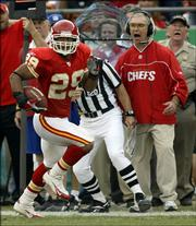 Kansas City strong safety Sammy Knight (29) runs along the sideline past defensive coordinator Gunther Cunningham, right, as he returns a fumble recovery for a touchdown in the third quarter. The Chiefs beat the Redskins, 28-21, Sunday in Kansas City, Mo.