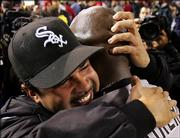 Chicago White Sox manager Ozzie Guillen, left, hugs pitcher Jose Contreras as they celebrate after winning the American League pennant. The White Sox beat the Los Angeles Angels, 6-3, Sunday in Anaheim, Calif., and clinched a spot in the World Series.