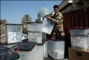 An Iraqi soldier loads ballot boxes in a truck to ship them for counting in Baghdad, Iraq. Election officials on Sunday counted millions of paper ballots from Iraq's constitutional referendum.