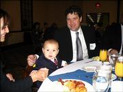 Anthony Kasson, 15 months old, joins his father, Mark Kasson, president and CEO of Free State Credit Union, at the Lawrence Holidome. They were among more than 160 people to attend the Excellence in Commerce awards presentation Monday. FSCU was a finalist for an award.