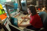 "Laura Watkins, a kansas university senior from Lenexa, plays CDs and LPs on her KJHK radio show ""Breakfast for Beat Lovers."" KU&squot;s KJHK-FM radio station celebrates its 30th anniversary this month."