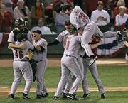 Houston's Luke Scott (30) leaps on top of teammates as they celebrate their victory over St. Louis. The Astros defeated the Cardinals, 5-1, Wednesday night in St. Louis to claim the NL championship series, 4-2.