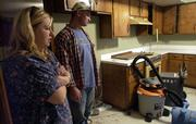 Beth and Mike Clover stand in the kitchen of their home, which was flooded during the recent Boardwalk Apartments fire. The Clovers have had to strip the house after it was flooded when the sewer became overwhelmed with the runoff of water used to fight the fire at the apartments.