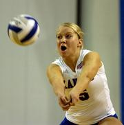 Kansas University's Liz Ingram returns a serve against Iowa State. KU fell to the Cyclones, 3-1, Wednesday at Horejsi Center.