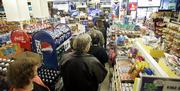 A line of people in a convenience store waits to buy Powerball tickets in Portland, Ore. Odds of winning the $340 million dollar jackpot were one in 146 million, but that wasn't stopping those who think the odds are worth a shot and enjoy dreaming about how to spend all that dough.