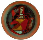 "An enameled abstract design of a woman on a red background decorates this tray-shaped piece of copper. It&squot;s signed ""Ellamarie & Jackson Wooley, California."" It sold recently for $200."