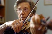 Eleanor Allen has been teaching violin in Lawrence for decades. One of her former students, Brian Lewis, is returning Sunday to play in a concert in honor of Allen's 90th birthday.