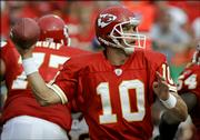 Kansas City Chiefs quarterback Trent Green throws a pass against the Washington Redskins. Green and his teammates must overcome a short week of practice in tonight's game against the Dolphins in Miami. The game was pushed up two days because of the threat posed by Hurricane Wilma.
