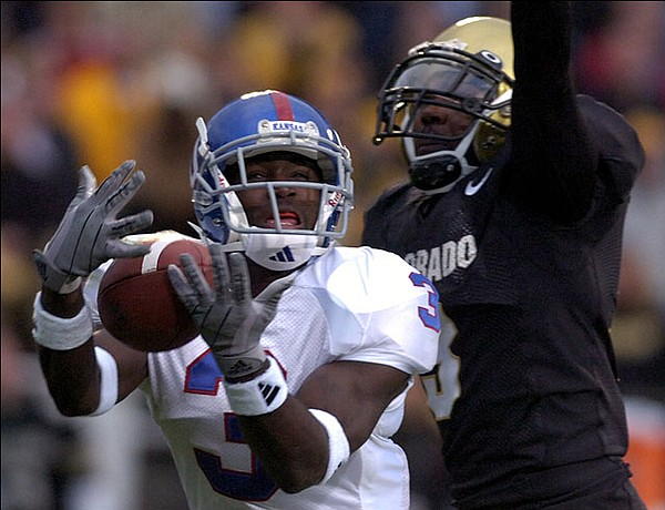 Kansas receiver Charles Gordon pulls in a long pass from quarterback Jason Swanson under the coverage of Colorado safety Tyrone Henderson in the first quarter of the KU-CU game Saturday in Boulder, Colo., in October, 2005.