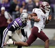 Texas A&M quarterback Reggie McNeal (1) gets past Kansas State safety Maurice Porter for a touchdown. The Aggies beat the Wildcats, 30-28, Saturday in Manhattan.